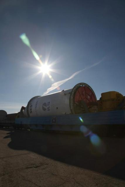 Encapsulated payload being transferred by rail from H101 to H111